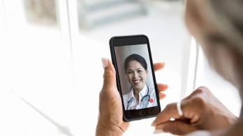 Person attending telehealth appointment on smartphone