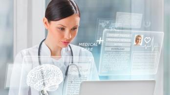 Nurse accessing digital patient information.