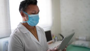 A nurse holding a tablet