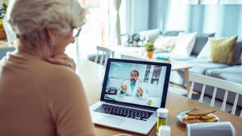 A patient speaks to a doctor via telehealth