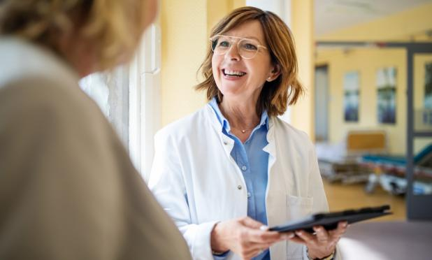 Doctor discussing with patient at nursing home