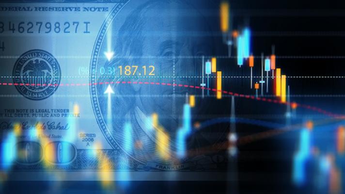 Digital graph and hundred-dollar bill