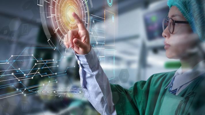 Surgeon touching digital interface