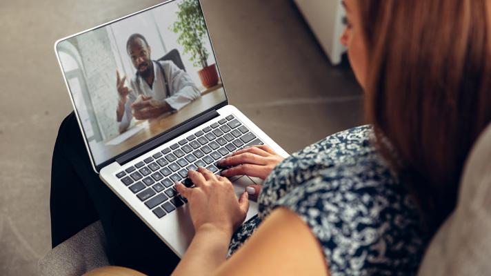 A telehealth visit via laptop