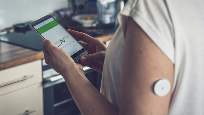 Patient with remote monitoring sensor at home