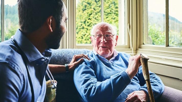 Care worker talking to senior man