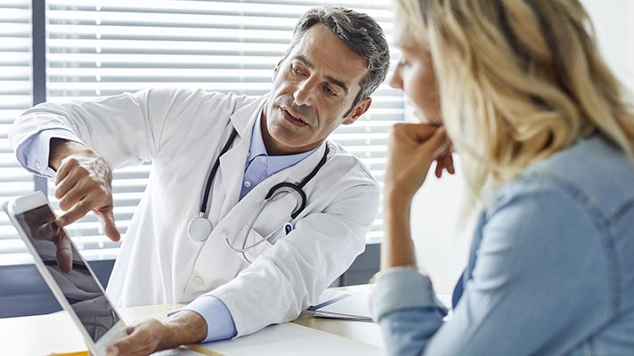 doctor talking with patient about health data