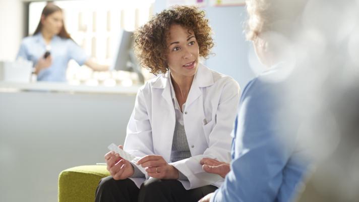 Pharmacist assisting senior customer.