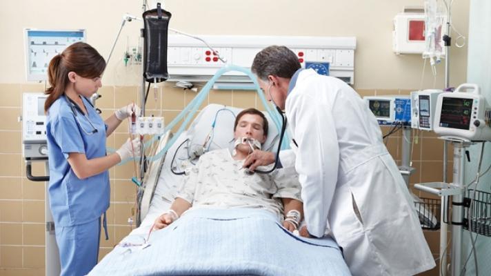 Doctors tending to sick patient