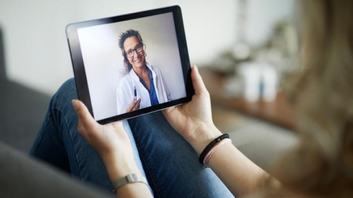 clinician on a tablet
