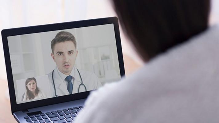 A person talking to a doctor on a computer screeen