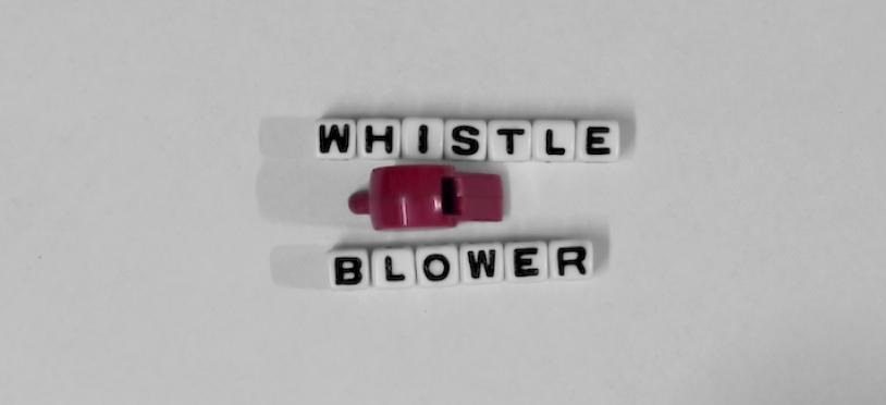 "Whistle and ""Whistle blower"" written in block letters."