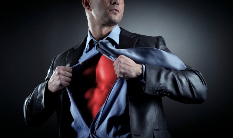 man in business suit with superhero costume