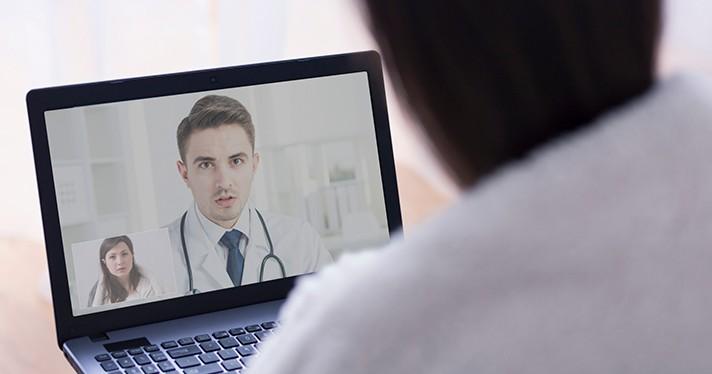 A telehealth consultation via laptop