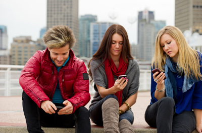 Young adults with smartphones