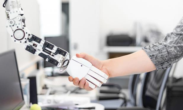 Man shaking hands with a robot.