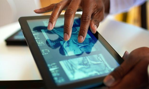 Doctor looking at a medical image on a tablet